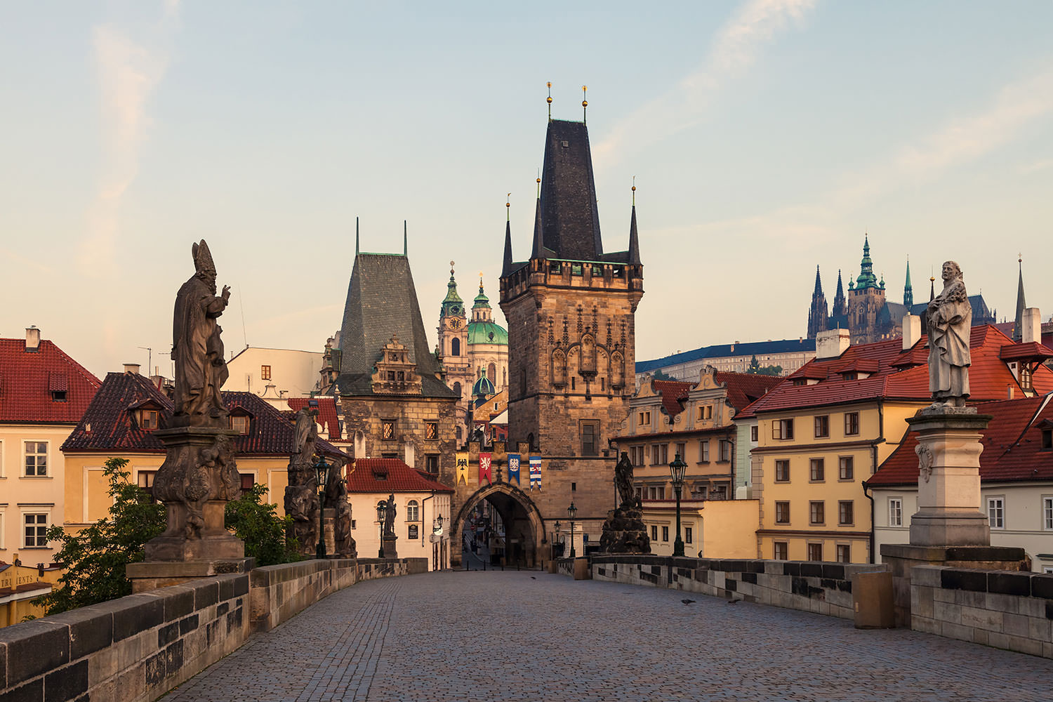 The Lesser Town Bridge Tower (Malostranská mostecká věž), Prague Castle (Pražský hrad) and Charles Bridge (Karlův most) at Sunrise, Prague, Czechia